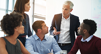 Image of Group of colleagues listening to one person