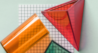 Image of Three plastic shapes on top of drawing paper